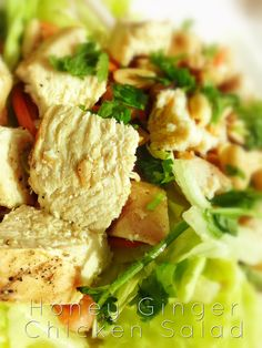 Honey Ginger Chicken Salad: marinated grilled chicken served over romaine and napa cabbage, carrots, scallions, tomatoes, peanuts and cilantro tossed with a honey ginger dressing.