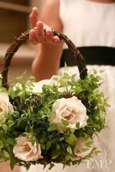 Risultati immagini per basket flowers for wedding