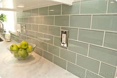 subway tile backsplash ideas for the kitchen. This glass subway tile in a seaglass green looks great with marble countertops #Subwaytiles