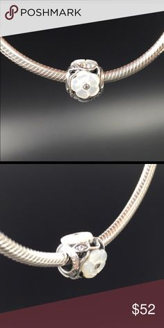 """Pandora Charm NWOT Pandora """"Luminous Florals"""" charm. Sterling silver, cubic zirconia and mother of pearl.  Properly hallmarked S925 ALE. Pandora box not available. No trades or off-Posh transactions. Thanks and happy Poshing!! Pandora Jewelry Bracelets"""