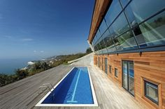 low energy hillside overlook house with rooftop lawn