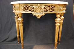 #Halfmoon console in #giltwood. Four fluted legs with a pattern of acanthus leaves. Top in #Carrara marble. #18th century. For sale on Proantic by Antiquités Paul Azzopardi.