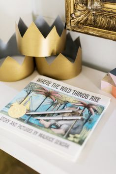 Gold crowns and 'Where the Wild Things Are' book for baby shower idea