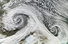 Two cyclones are seen, after forming in tandem in November 2006. The Moderate Resolution Imaging Spectroradiometer (MODIS) onboard NASA's Terra satellite took this picture of the two cyclones south of Iceland on November 20 (South is up in image). (NASA/Jesse Allen, Earth Observatory) #