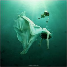 """Evodia """"Echo"""" I watched as her body floated deeper and deeper into the fingers of the dark transparent ocean. The water. It can sustain life or take it away. Now it was claiming Evodia's. Her white and silver dress floated around her sinking body, as if she were laying on a cloud."""
