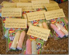 End of school party favors include 2 sidewalk chalks, a packet of Koolaid, and a bookmark with a fun summer tag.