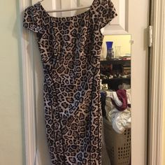 Leopard Print Dress Size 2, Victoria's Secret This super-sexy leopard print dress is fitted and hits just below the knee. Zips down the back. Cap sleeves, slightly low back(but just covers bra band!) 92% polyester and 8% elastane offers a bit of stretch. Machine washable. Form-fitting and sexy and able to dress up or down. I've worn this to work with red flats and a cream cardigan(I'm a teacher) and out for cocktails with heels. Purchased from the Victoria's Secret website, before they…