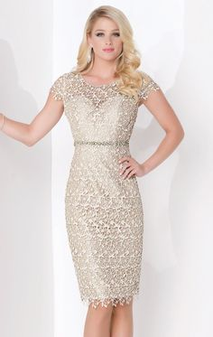 You cannot go unnoticed in Social Occasions by Mon Cheri 115866. This ethereal creation features a scoop neckline with short sleeves. The rich lace wraps the top over sweetheart lining. Cinched at the natural waist with beaded band, the short sheath skirt is finished with a scalloped hem for added flair.
