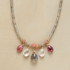 FIVE IN A ROW NECKLACE--Thoi Vo created this gemstone row necklace, in which a quintet of gems drips from labradorites sparked with rhodochrosite, violet garnet, pink tourmaline, Oregon sunstone and rose quartz. 14kt vermeil and 14kt goldfill