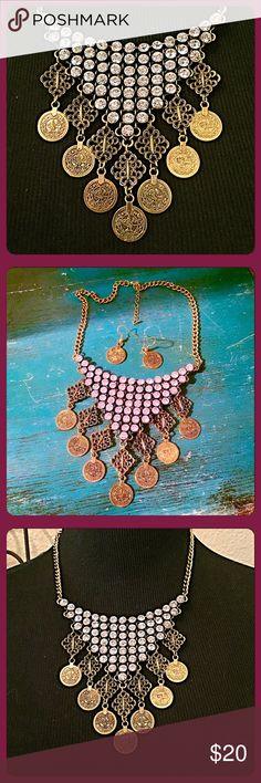 """✨Stunning Crystals & Coins Necklace & Earrings✨ Just a great standout piece to pop a black dress or a piece to adorn your neckline. Bright crystals and dangling coins makes this an eye catcher! Length=16"""" w/a 2"""" extender. Lobster claw clasp. Center drop= 4"""". Matching brass earrings are about 1.25""""L. Brass base metal. Brand new, never worn. boutique Jewelry Necklaces"""