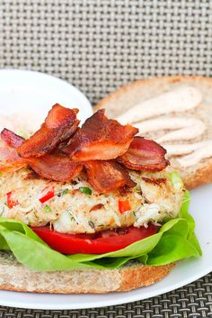 Crab Cake BLT with Old Bay Mayo | REcipe by: Tom Douglas | I made these crab cake blts. I love crab cakes, and I love bacon, so why not pair the two together? Tom Douglas' recipe seemed the most popular, but instead of his horseradish mayo, I made an Old Bay mayo. I thought it complemented both the bacon and the crab cake. | From: kokocooks.com