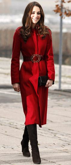wool red coat by British brand L.K. Bennett, which she accessorized with an oversize patent red belt. Stuart Weitzman knee-high suede boots