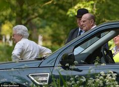 Fun in the sun: The Queen wears a pair of shades as she leaves her car with husband Prince...