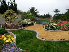 simple yet stylish.  curved pathways with a mix of lawn, and flower beds.  Nice stone for the edges