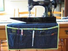 denim sewing projects - Denim pouch to hold all your sewing stuff that fits under your machine and hangs down. Pockets for scissors, pins etc... Need to make this!