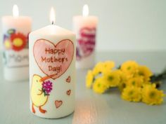 Candle Art Transfer - Every time your mom goes to light this candle, she'll think of you thanks to the do-it-yourself candle art. You can transform any plain candle into a personalized candle for mom. We added lots of flower, hearts, and Mother's Day phrases to our candles! What does your mom like?