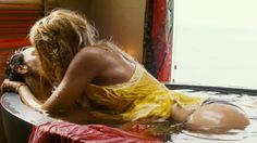 No relaxed but still doing it: Taylor Kitsch and Blake Lively in Oliver Stone's new thriller, Savages. Picture: Relativity Media