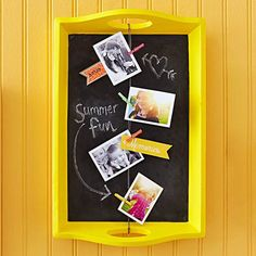 A seldom-used or thrifted wooden tray easily transforms into an adorable chalkboard that's perfect in it's new role as a photo display: http://www.bhg.com/christmas/crafts/cute-craft-christmas-gifts/?socsrc=bhgpin120414traychalkboard&page=2