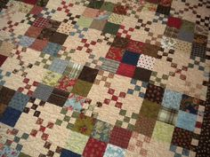 Beautiful quilt with small 9 patches and big 9 patches...