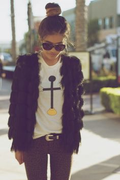 top knot, skinnies, and shaggy jacket.