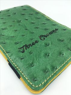 Genuine leather golf scorecard holder with engraved personalization.