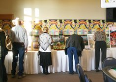 The silent auction had some amazing items from fine art prints to gift baskets, vacations, bird feeds, patio heating to boots and jewelry.  Something for everyone and bid they all did!