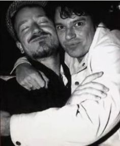 Bono with Michael Hutchence. Breaks my heart to see this picture, because thay both seem so happy... :'(