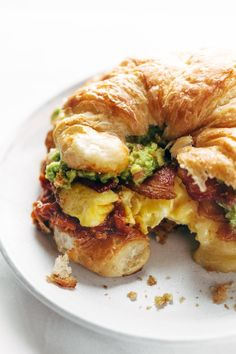 The Ultimate Breakfast Sandwich with eggs bacon guacamole chunky tomato sauce pepper jack cheese all on a toasted croissant Favorite ever Croissant Breakfast Sandwich, Breakfast Sandwich Recipes, Breakfast Desayunos, Avocado Breakfast, Gourmet Breakfast, Mexican Breakfast, Breakfast Recipes With Eggs, Good Breakfast Ideas, Avocado Toast
