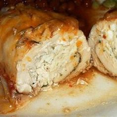 Cream Cheese, Garlic, and Chive Stuffed Chicken - This is a great recipe and I swear you could put just about anything rolled up inside a chicken breast and it's bound to be good. The result was a very moist and flavorful chicken bursting with a delicious cream cheese and bacon center!