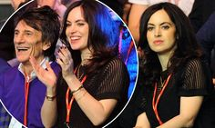 Ronnie Wood, 68, and his pregnant wife Sally, 38, enjoy the snooker