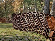 Lincoln, Massachusetts at the home of Bob Davoli and Eileen McDonagh, the fence was designed by landscape architect Mikyoung Kim out of steel...