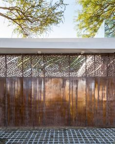 FCP Arquitectura Mooe House contrasts solid white walls with perforated iron screens International Style, Architectural Features, Private Room, White Walls, House, Exterior Design, Valance Curtains, Architecture Design, Floor Plans