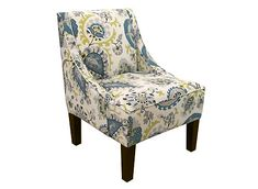 Add instant style to your living room with the Tatum accent chair. Its cool-toned floral pattern will add a calming yet colorful accent to your space, as well as texture and depth. And for comfort, rely on the plush foam padding and sloped arms as you relax.