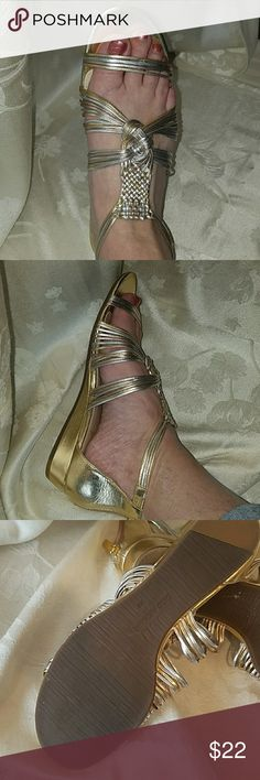 """Enzo Angiolini Nessta Sandals The Nessta sandal features a woven multi-strap upper, a back zipper and a low wedge heel.  Heel Height: 1"""" Fit: True to Size Upper: Synthetic Enzo Angiolini Shoes Sandals"""