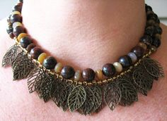 Two strands of Iron Tiger Eye with Faceted Agate and bronze colored metal leaf dangles separated by small seed beads & a metal toggle clasp