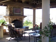Outdoor fireplace in a covered patio