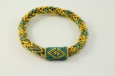 Kumihimo Beaded Bracelet with peyote stitched clasp.