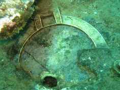 "The ""lucky porthole"" on the Wreck of the Rhone in the British Virgin Islands. All divers are supposed to rub it for good luck - hence the shiny brass underwater. We did our good deed and kept that thing gleaming."