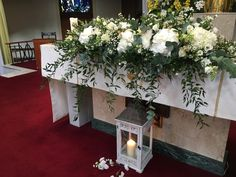 Church altar flowers with unity candles