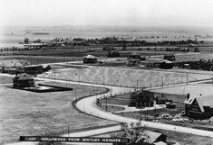 ca. 1903)^ - Panoramic view of Hollywood from Whitley Heights circa 1903, looking southwest toward Highland and Franklin Avenues. The neighborhood is dotted with homes. The curved configuration of Highland between the East and West sections of Franklin Ave still exists today. The larger structure, seen on the left side of the photo, is the famous Hollywood Hotel. It is situated on the Northwest corner of Hollywood Blvd. and Highland Ave.
