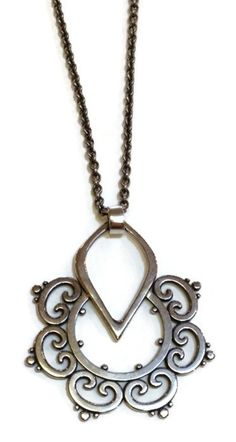 """Sasha Bell Jewelry - Large Ornate Tribal Pendant Show here is Sasha Bell's Large Ornate Tribal Pendant rendered in Sterling Silver. This gorgeous pendant hangs from a 18"""" sterling silver chain and mea"""