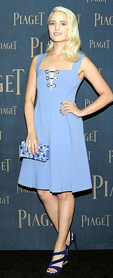 Dianna Agron beauty posed in a periwinkle Miu Miu dress, complete with small floral buttons on the lace-up bodice, and a Prada stone-embellished box clutch.