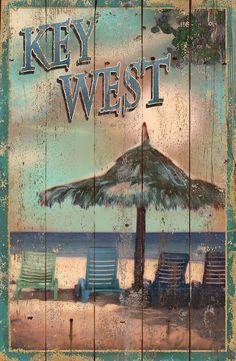 Vintage-like coastal beach wood sign advertising an adventure to a Key West beach resort!