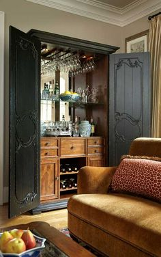 the madeira beverage cabinet is an elegant addition to any home armoire styling and decorative wooden scrollwork open to reveal a full bar cabinet complete