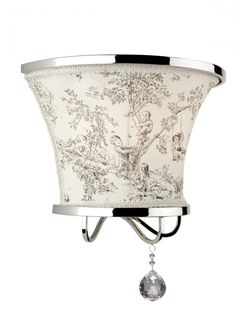 This toile linen shade wall sconce with crystal accent from Artcraft is super stylish.
