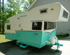 Restored 1964 Shasta Astroflyte travel trailer. My Grandparents had a camper just like this minus the turqouise.  I had some great camping memories from that camper!