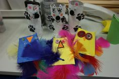 Owl shakers! These ideas I actually got from Pinterest and modified a bit. We made these cool shakers out of painted toilet paper rolls. We added rice into them to make them shakers. Folding and gluing the tops shut was the hardest part really. Then we added the feathers to the bottom and stapled them shut. Everyone enjoyed both making them and playing with them!