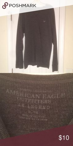 American Eagle Thermal Knit Henley Very warm and comfortable. Sleeves run long. Picture makes it look black but it's definitely a dark gray. American Eagle Outfitters Shirts Tees - Long Sleeve