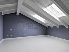 empty room in the attic with wood ceiling