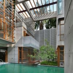 Concrete constructed bachelor pad in Bangladesh built around incredible pool.